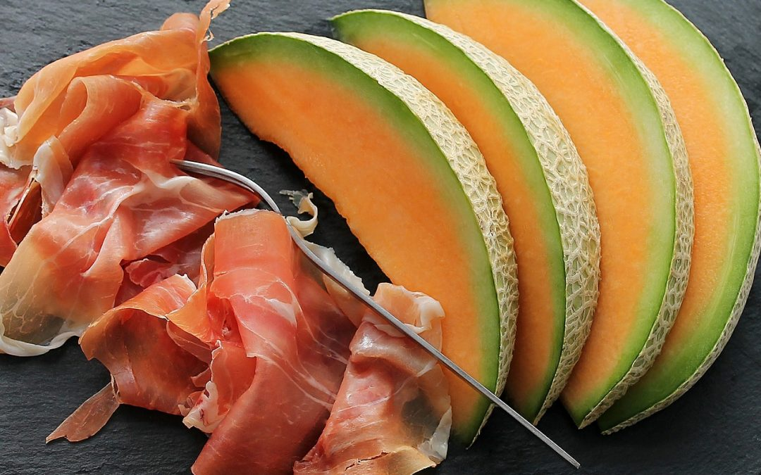 Ham and melon on a slate
